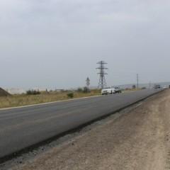 Первый слой асфальта на севастопольском участке трассы «Таврида» уложен на 30% фото